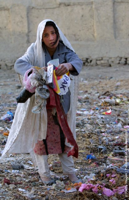 Roina,10, works on the street collecting garbage January 1, 2002 after leaving the Aschiana Child Center, a drop in center for street children in Kabul, Afghanistan