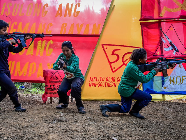 Fighters of the New People's Army-Melito Glor Command (NPA-MGC) conduct a drill during their 50th founding anniversary celebration at an undisclosed location in the mountains of Sierra Madre, Philippines, 31 March 2019. Setbacks in battle, surrenders and infighting have weakened the guerrilla group, which is considered a terrorist organisation by the US and remains a major security threat in the Philippines. (Photo by Alecs Ongcal/EPA/EFE)