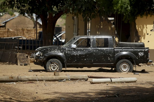 A military vehicle with bullet holes is seen abandoned along a road in Bazza after the Nigerian military recaptures the town of Michika and surrounding villages from Boko Haram, Adamawa state May 10, 2015. (Photo by Akintunde Akinleye/Reuters)