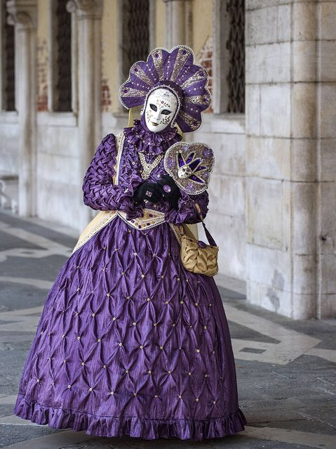A woman dressed in Carnival Costume poses at the Doge Palace in Venice. (Photo by Marco Secchi/Getty Images)