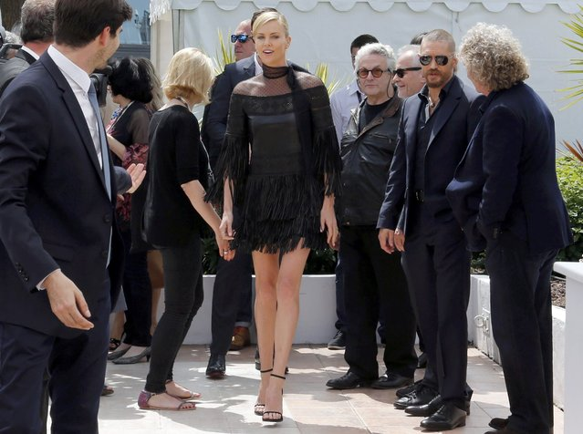 "Cast members Charlize Theron (C) and Tom Hardy (2ndR), director George Miller (4thR) arrive to attend a photocall for the film ""Mad Max: Fury Road"" out of competition at the 68th Cannes Film Festival in Cannes, southern France, May 14, 2015. (Photo by Regis Duvignau/Reuters)"