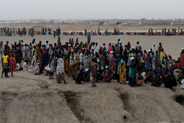 People wait to receive food inside the United Nations Mission in South Sudan (UNMISS) Protection of Civilians site (PoC), near Bentiu, northern South Sudan, February 10, 2017. (Photo by Siegfried Modola/Reuters)