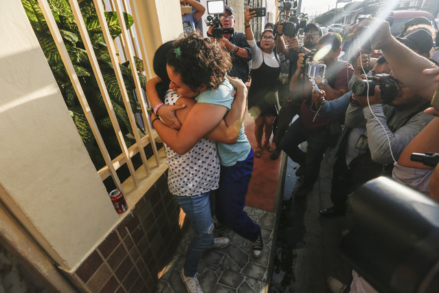 Opposition member María Adilia Peralta Cerratos is embraced by a relative as she returns home after being in prison, in Masaya, Nicaragua, Monday, May 20, 2019. Peralta Cerratos is one of 100 prisoners the Nicaraguan government released Monday in a form of house arrest, including three human rights activists. (Photo by Alfredo Zuniga/AP Photo)
