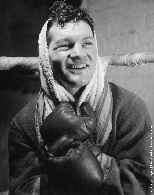 1950: Btritish heavyweight boxer Bruce Woodcock in cheerful mood after a training session