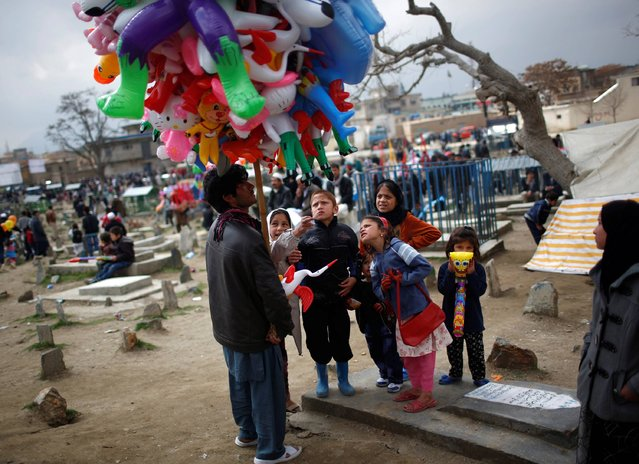 Children buy toys during the Afghan New Year (Newroz) celebrations in Kabul March 21, 2014. (Photo by Ahmad Masood/Reuters)