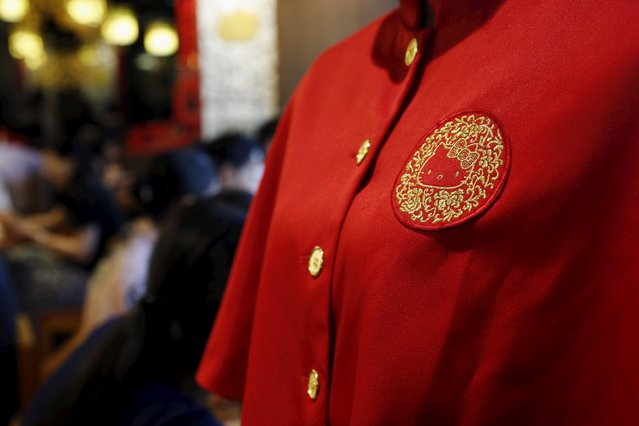 A Hello Kitty image is seen on the uniform of a waitress at a Hello Kitty-themed Chinese restaurant in Hong Kong, China May 21, 2015. (Photo by Bobby Yip/Reuters)
