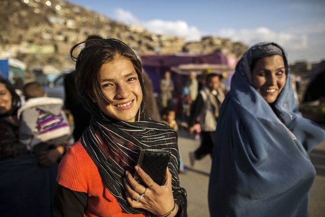 A girl smiles as she walks after visiting the Sakhi shrine in Kabul March 26, 2014. (Photo by Zohra Bensemra/Reuters)