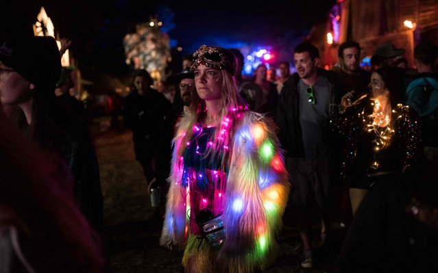 Revellers experience the Block9 area of the Glastonbury Festival of Music and Performing Arts on Worthy Farm near the village of Pilton in Somerset, South West England, on June 28, 2019. (Photo by Oli Scarff/AFP Photo)