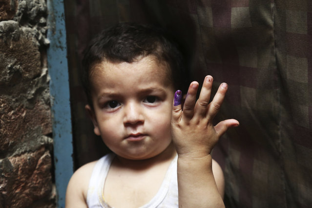 A Pakistani child shows his finger being marked after receiving the polio vaccine in Lahore, Pakistan, Wednesday, April 24, 2019. A Pakistani health official says two new polio cases have been reported in the country's northwest despite efforts against the crippling disease. (Photo by K.M. Chaudary/AP Photo)