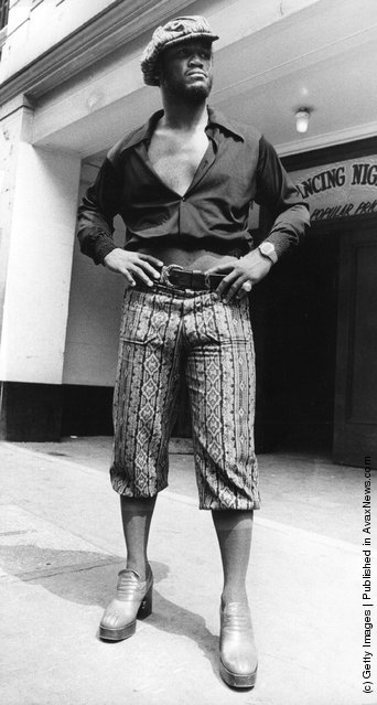 1973: Joe Frazier, World Champion Heavyweight boxer models clothing at Leicester Square Empire Ballroom