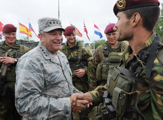 Supreme Allied Commander Europe U.S. Gen. Philip M. Breedlove speaks with a soldier of the Royal Dutch Army after the NATO Noble Jump exercise on a training range near Swietoszow Zagan, Poland, Thursday, June 18, 2015. (AP Photo/Alik Keplicz)