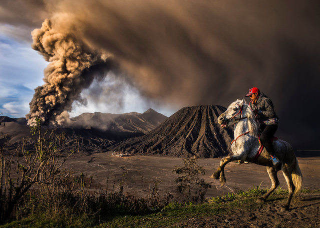 The Mount Bromo volcano erupts in the Bryce Canyon, Utah. (Photo by Reynold Dewantara/2016 National Geographic Travel Photographer of the Year Contest)