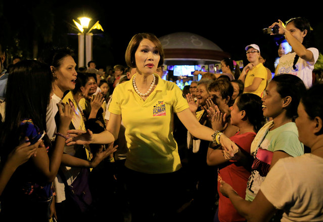 "Geraldine Roman, a transgender congressional candidate, (C) is greeted by her supporters during a ""Miting de Avance"" (last political campaign rally) for the national election in Orani town, Bataan province, north of Manila in the Philippines May 6, 2016. (Photo by Romeo Ranoco/Reuters)"