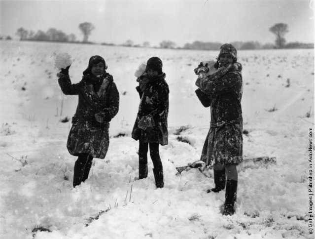 1927: Girls throwing snowballs at Havering, Essex, where the snow has reached a considerable depth