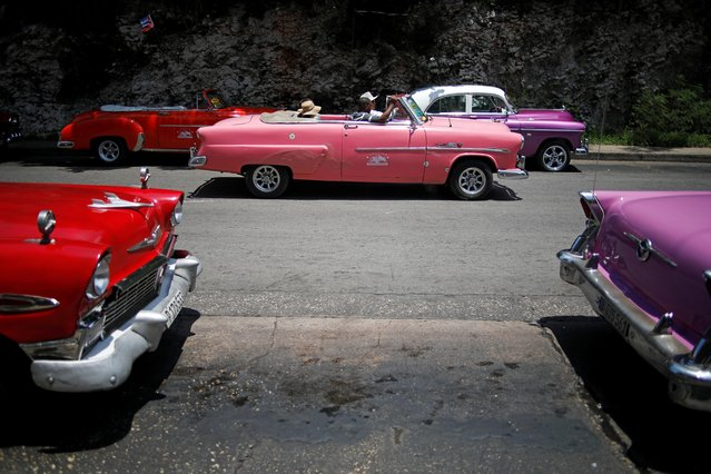 ourists ride in a vintage car in Havana, Cuba on August 21, 2019. (Photo by Fernando Medina/Reuters)