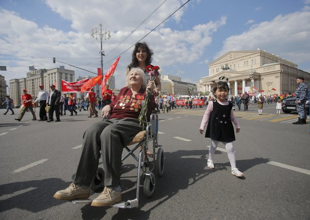 A World War Two veteran takes part in the Victory Day celebrations, marking the 71st anniversary of the victory over Nazi Germany in World War Two, in front of the Bolshoi Theatre in central Moscow, Russia, May 9, 2016. (Photo by Maxim Shemetov/Reuters)