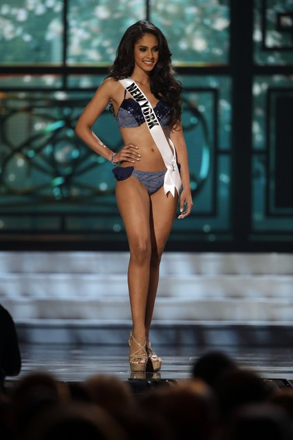 Miss New York, Thatiana Diaz, competes in the bathing suit competition during the preliminary round of the 2015 Miss USA Pageant in Baton Rouge, La., Wednesday, July 8, 2015. (Photo by Gerald Herbert/AP Photo)