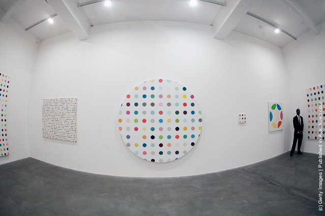A security guard watches over the artist Damien Hirst's exhibition The Complete Spot Paintings, with the Cycloheximide, 2007