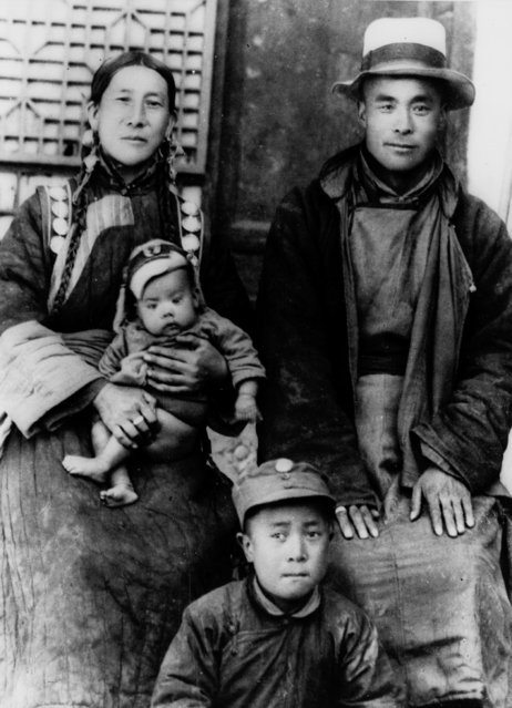 Proud parents of the 14th Dalai Lama pose in Tibet on February 21, 1940 with two other sons. The infant peasant boy will be installed spiritual and temporal leader of Tibet on Feb. 22. (Photo by AP Photo)