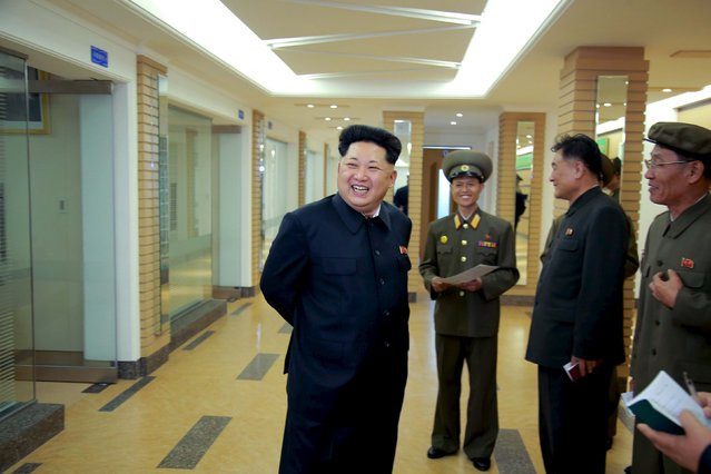 North Korean leader Kim Jong Un (L) provides field guidance at the newly built National Space Development General Satellite Control and Command Centre in this undated photo released by North Korea's Korean Central News Agency (KCNA) in Pyongyang May 3, 2015. (Photo by Reuters/KCNA)