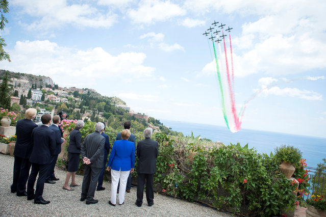 G7 leaders watch an Italian flying squadron as part of activities at the G7 summit in Taormina, Sicily Italy, May 26, 2017. (Photo by Guido Bergmann/Reuters/Courtesy of Bundesregierung)
