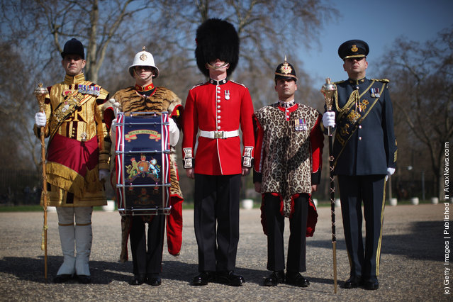 (L-R) Senior Drum Major Betts of the Scotts Guard, Bugler Lee Kidd, Guardsman Adam Deer of the Coldstream Guards and Lance corporal Michael Strong of the Princess of Wales's Royal Regiment pose in their full ceremonial attire at Wellington Barracks