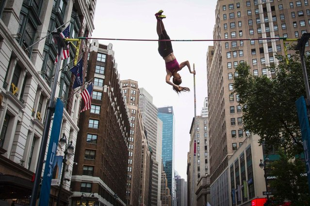 Greek pole vaulter Ekaterini Stefanidi clears the bar in a promotional Pole Vaulting event in Herald Square in Manhattan. (Photo by Andrew Kelly/Reuters)