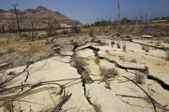 A cracked road is seen at an abandoned vacation resort on the shore of the Dead Sea near Kibbutz Ein Gedi, Israel July 27, 2015. (Photo by Amir Cohen/Reuters)