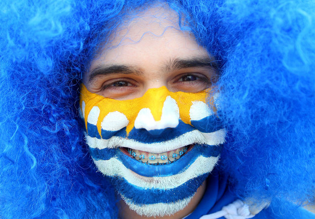 "A Uruguay fan with painted face, blue wig and blue braces on his teeth outside Arena Corinthians 2014 FIFA World Cup, Group D, Uruguay v England, Arena Corinthians, S""o Paulo, Brazil, on 19 June 2014. (Photo by Kieran McManus/Rex Features)"