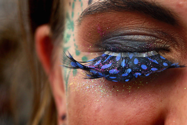 A festival goer displays her false eyelashes at Worthy Farm in Somerset, on the second day of the Glastonbury music festival June 26, 2014. (Photo by Cathal McNaughton/Reuters)