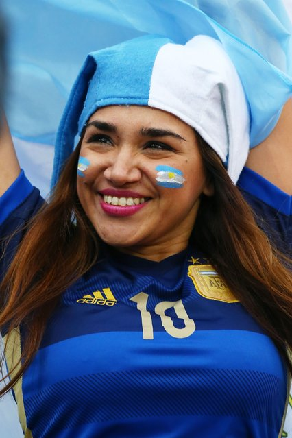 An Argentina fan enjoys the atmosphere prior to the 2014 FIFA World Cup Brazil Semi Final match between the Netherlands and Argentina at Arena de Sao Paulo on July 9, 2014 in Sao Paulo, Brazil. (Photo by Ronald Martinez/Getty Images)