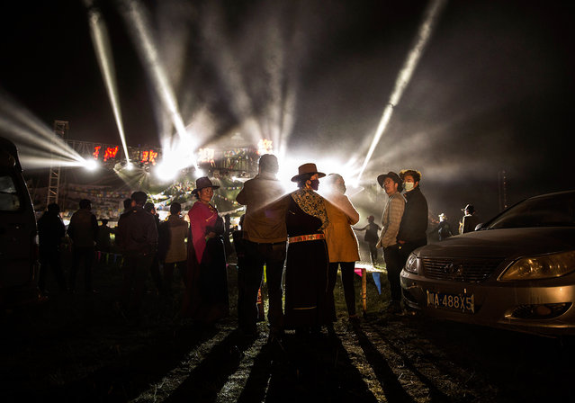 Tibetan nomads watch a laser show at a local festival on July 26, 2015 on the Tibetan Plateau in Yushu County, Qinghai, China. (Photo by Kevin Frayer/Getty Images)