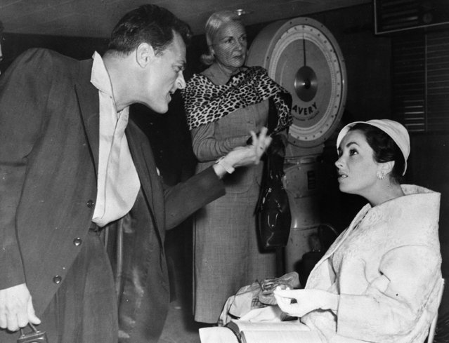American film director Mike Todd and his actress wife Elizabeth Taylor get into a spat after missing their flight from London to Nice, June 22, 1957. (Photo by AP Photo)