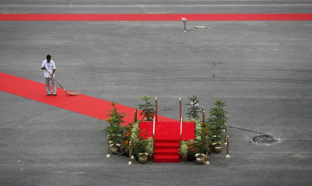 A man sweeps the red carpet before the arrival of Indian Prime Minister Narendra Modi at the historic Red Fort during Independence Day celebrations in Delhi, India, August 15, 2015. (Photo by Adnan Abidi/Reuters)