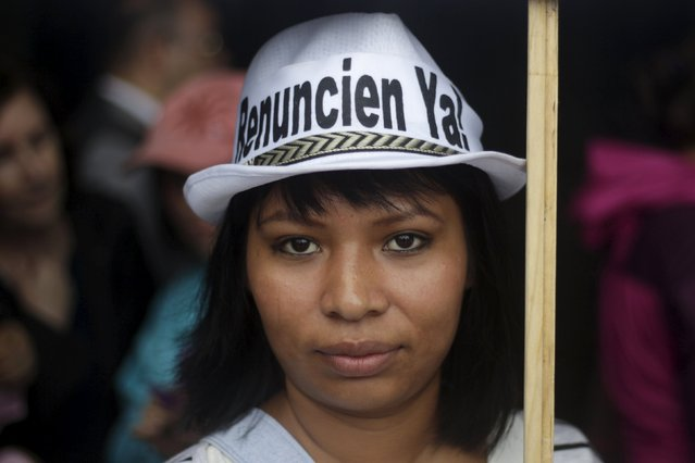 A demonstrator poses for a picture during a protest to demand the resignation of Guatemala's President Otto Perez Molina in Guatemala City, August 15, 2015. (Photo by Josue Decavele/Reuters)