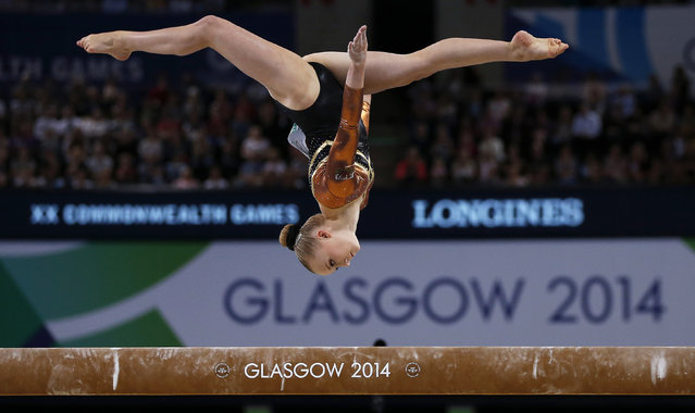 Georgina Hockenhull of Wales performs on the beam during the women's gymnastics apparatus final at the 2014 Commonwealth Games in Glasgow, Scotland, August 1, 2014. (Photo by Phil Noble/Reuters)