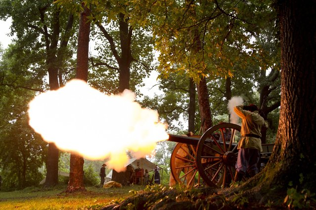 Civil War re-enactors fire a cannon every hour to commemorate the 150th anniversary of the Battle of Atlanta, in Atlanta, Georgia, July 19, 2014. (Photo by Christopher Aluka Berry/Reuters)