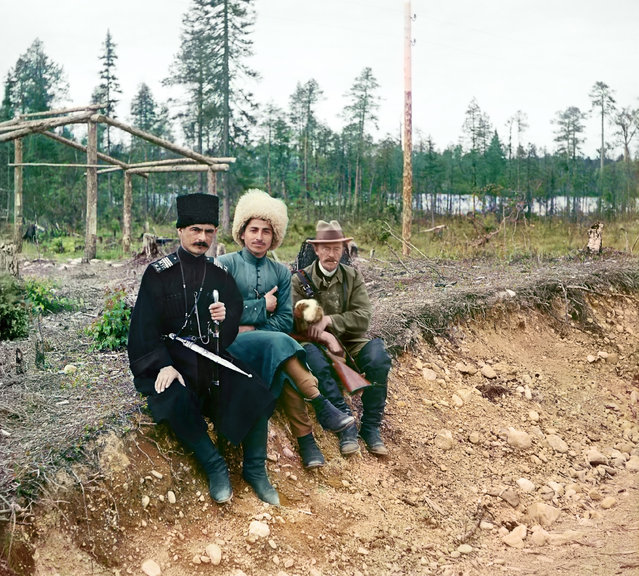 Photos by Sergey Prokudin-Gorsky. Group (Sergeĭ Mikhaĭlovich Prokudin-Gorskiĭ and two men in Cossak dress (?) seated on the ground). Russia, Arkhangelsk province, Kem' uyezd (district), Nadvoitsy village and outskirts, 1916
