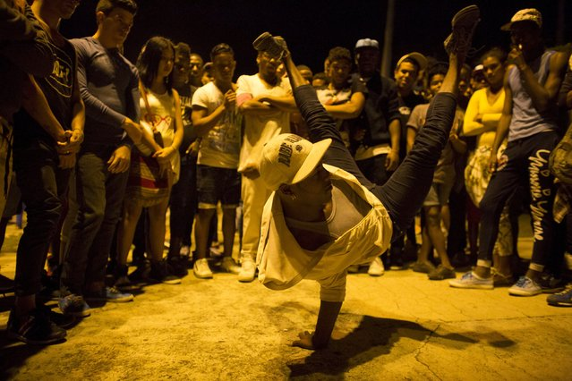A teenager break dances on the street in Havana, March 29, 2015. (Photo by Alexandre Meneghini/Reuters)