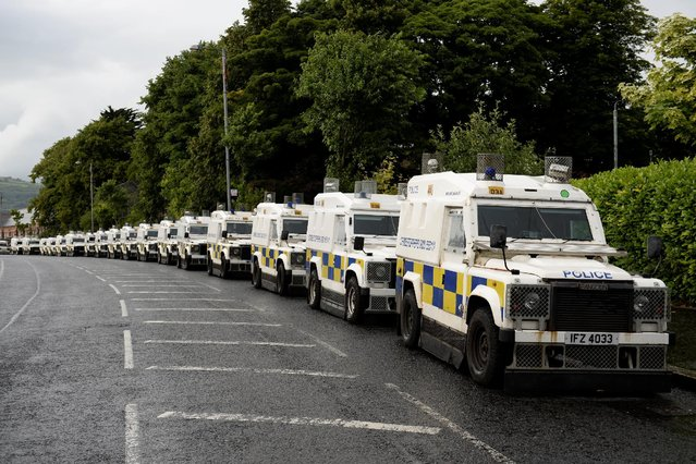 Armoured police vehicles are seen in the Ardoyne area, an interface between the Catholic and Protestant communities during the annual Twelfth of July Orange Order Parade in Belfast, Northern Ireland, July 12, 2016. (Photo by Clodagh Kilcoyne/Reuters)