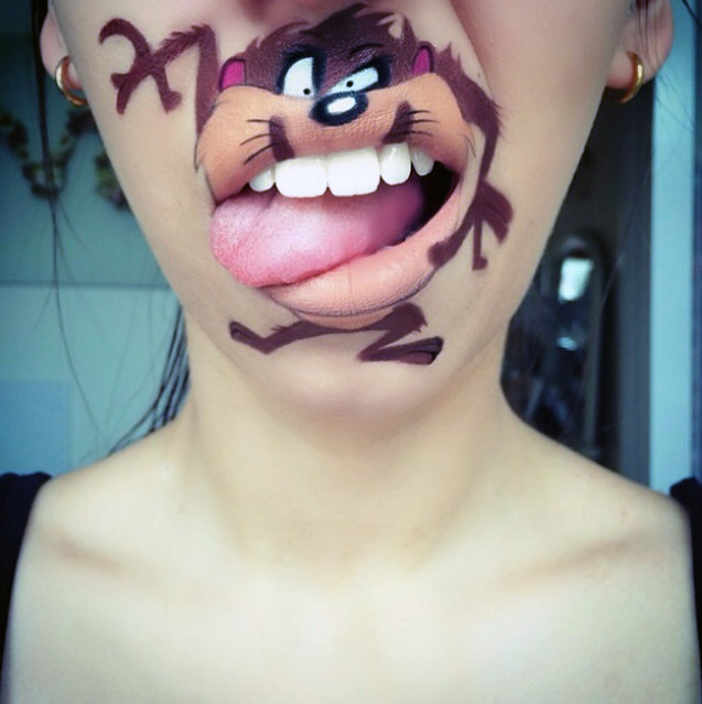 "Makeup artist Laura Jenkinson paints popular cartoon characters on her face, using her own mouth as the teeth and lips of her subjects. Here, Taz from ""Looney Tunes"" is depicted on Jenkenson. (Photo by Laura Jenkinson/Caters News)"