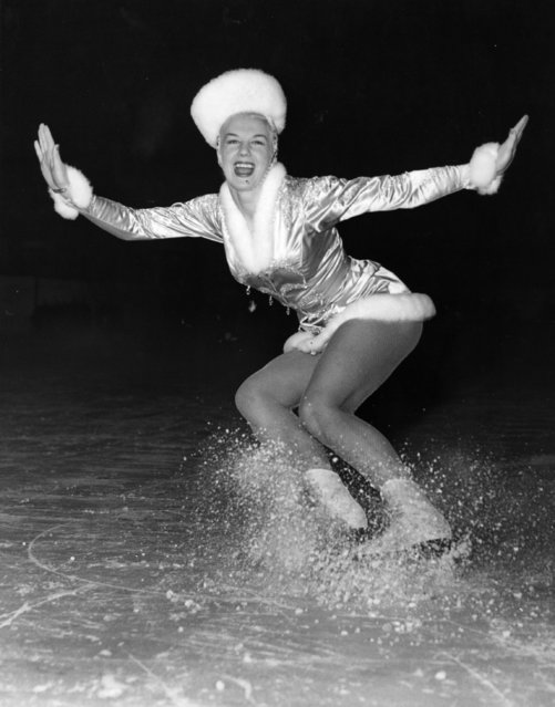 """Sheila Hamilton makes the ice fly during a rehearsal of one of her numbers """"Winter Wonderland"""" in the """"Cinderella"""" Ice show at the Empire Pool Wembley. 12th December 1952. (Photo by Fox Photos)"""