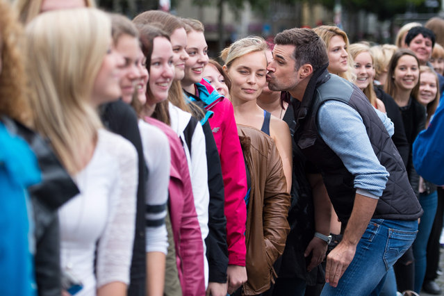 German actor Jo Weil sets a world record in speed-kissing in Cologne, Germany, 01 September 2015. Weil kissed 63 women in 30 seconds. (Photo by Marius BeckerEPA)