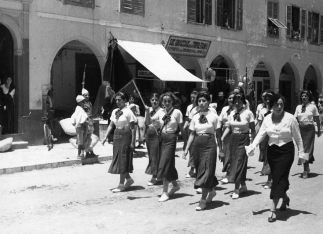 Black shirts are not worn, but these girls are members of the Italian Fascist organisation, taking part in a parade in Tripoli on review day, 1935. (Photo by Baron)