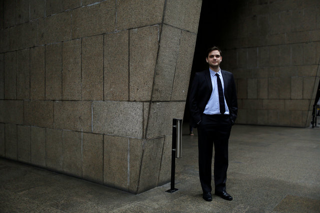 """Antonio Mariano de Azevedo, a 25-year-old political advisor, poses for a portrait in Rio de Janeiro, Brazil, July 21, 2016. When asked what he felt about Rio de Janeiro hosting the Olympics, Antonio said, """"Rio de Janeiro will not change after this event. For the government the Olympic infrastructure has been more important than investing in improved services for the population"""". He also said, """"I am against the Olympics, the city is in crisis"""". (Photo by Pilar Olivares/Reuters)"""