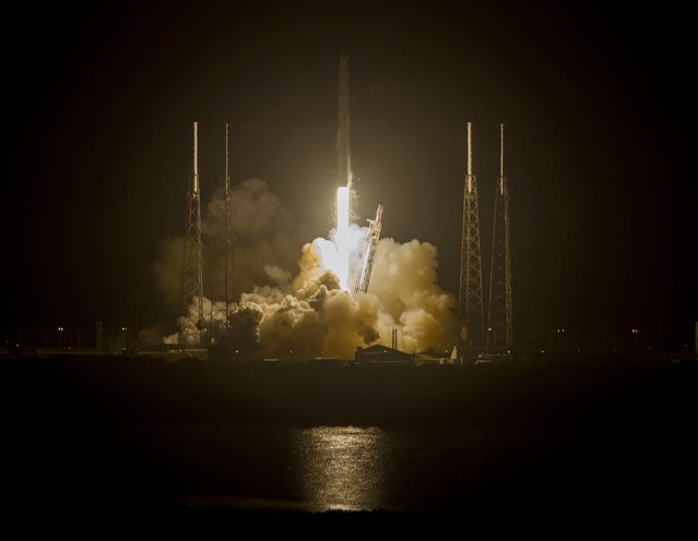A Falcon 9 rocket is launched by Space Exploration Technologies on its fourth cargo resupply service mission to the International Space Station, from Cape Canaveral Air Force Station in Florida September 21, 2014. The unmanned Falcon 9 rocket blasted off with more than 5,000 pounds (2,268 kg) of equipment, supplies and science experiments, including 20 live mice for medical experiments. (Photo by Michael Brown/Reuters)