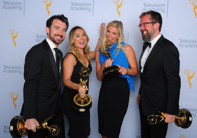 "Rhys Thomas, from left, Erin Doyle, Lindsay Shookus, and Erik Keyword, winners of the award for outstanding variety special for ""The Saturday Night Live 40th Anniversary Special"", pose for a portrait at the Television Academy's Creative Arts Emmy Awards at Microsoft Theater on Saturday, September 12, 2015, in Los Angeles. (Photo by Vince Bucci/Invision for the Television Academy/AP Images)"