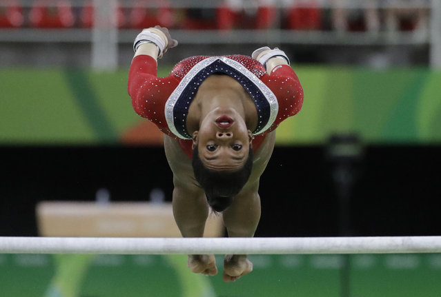 United States' Gabrielle Douglas performs on the uneven bars during the artistic gymnastics women's apparatus final at the 2016 Summer Olympics in Rio de Janeiro, Brazil, Sunday, August 14, 2016. (Photo by Julio Cortez/AP Photo)