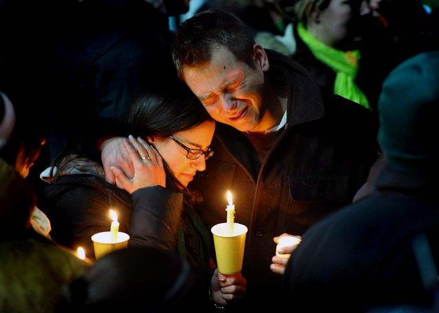 Ted Kowalczuk, of Milford, and his friend Rachel Schiavone, of Norwalk, attend a candlelight vigil held behind Stratford High School on the Town Hall Green in Stratford, Connecticut. Kowalczuk and Schiavone were close friends of Stratford High graduate Vicki Soto, a teacher at Sandy Hook Elementary School who was killed Friday.  (Photo by Christian Abraham/The Connecticut Post)