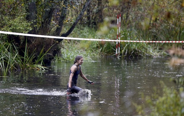 A woman takes part in an extreme run competition in Zhodino, east of Minsk, September 26, 2015. (Photo by Vasily Fedosenko/Reuters)